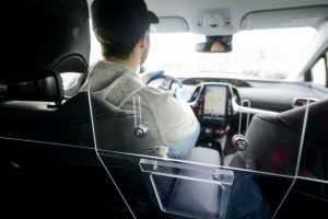 convenient pass through on passenger driver protective safety barrier